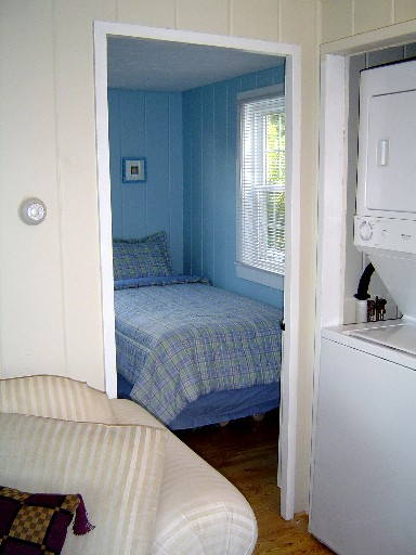 View Into Blue Bedroom From Living Room