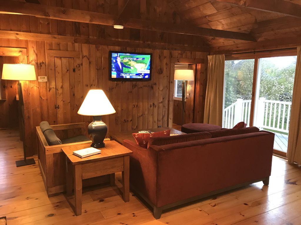 Living Room Towards Master Bedroom & Sliding Glass Door to Deck