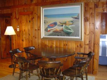 Living Room - Captain's Table & Doors to Bedrooms